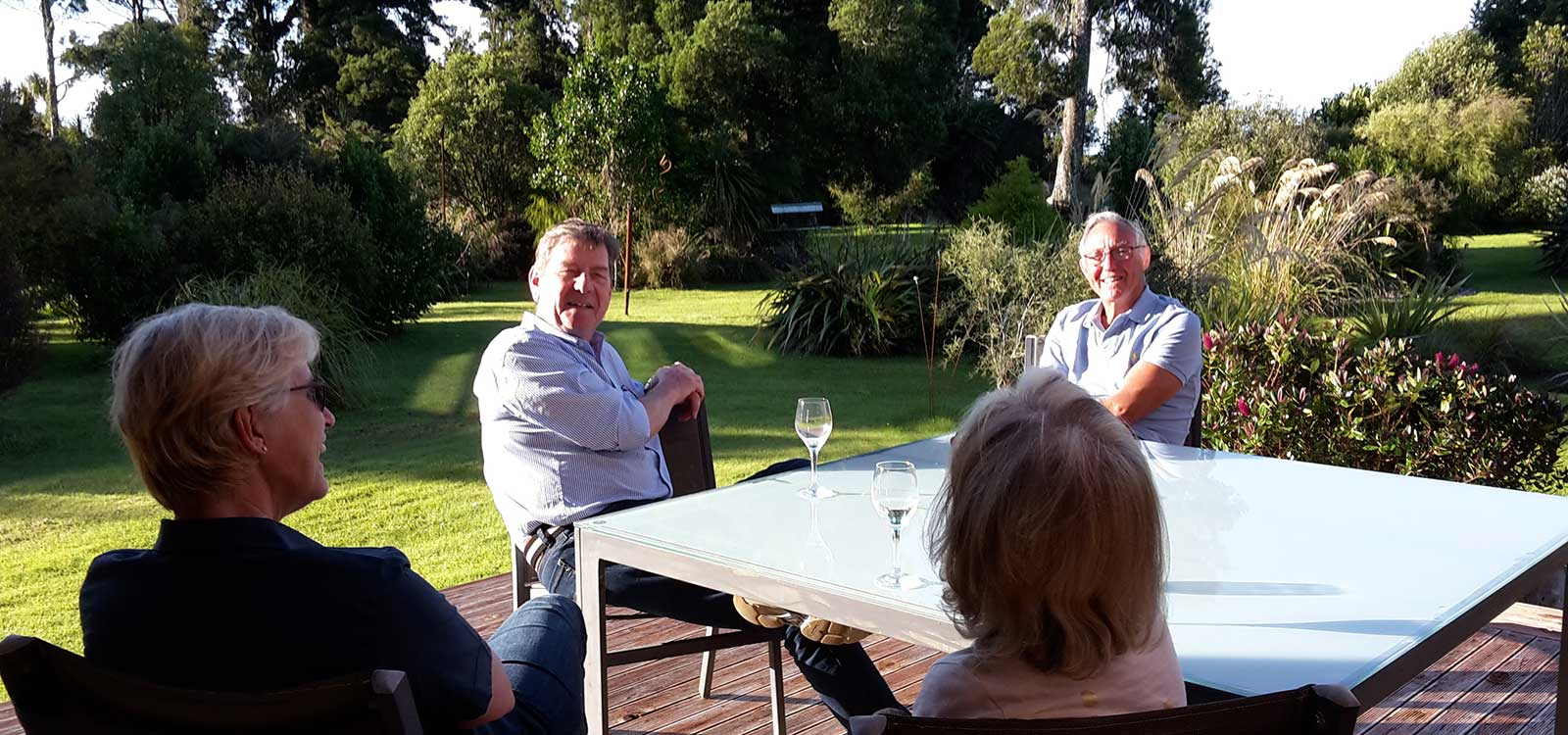 Guests enjoying a wine outside at Parmata Lodge