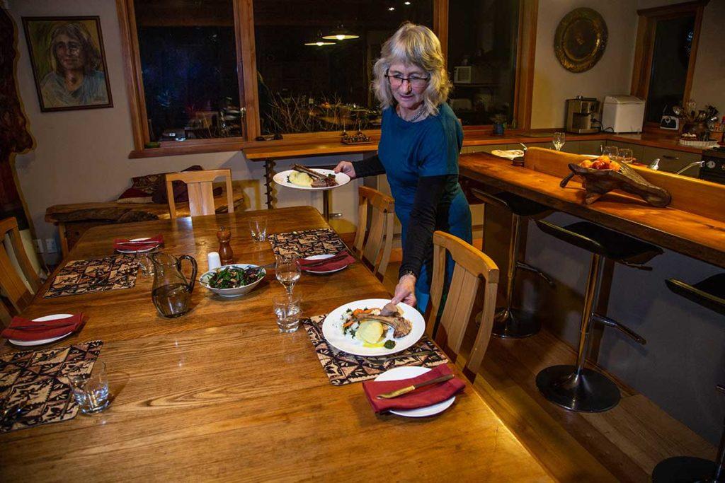 Kathy serving dinner